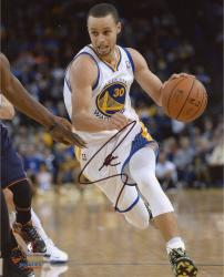 """Stephen Curry Golden State Warriors Autographed Dribbling 08"""" x 10"""" Photograph"""