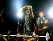 """Steven Tyler Autographed 11"""" x 14"""" Singing with Mouth Wide Open Photograph - PSA/DNA COA"""