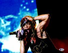 "Steven Tyler Autographed 11""x 14"" Aerosmith Grabbing Hat Photograph - BAS COA"