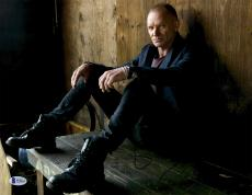 """Sting Autographed 11"""" x 14"""" Sitting in Wooden Room Photograph - Beckett COA"""