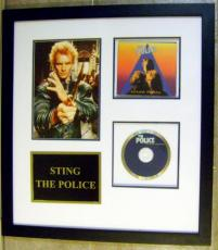 Sting autographed photo (The Police CD framed and matted)