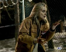 "Taylor Schilling Autographed 11"" x 14"" Orange is The New Black Chapman Outside with Bloody Hands Photograph - Beckett COA"