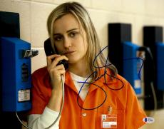 "Taylor Schilling Autographed 11"" x 14"" Orange is The New Black Chapman Talking on Jail Phone Photograph - Beckett COA"