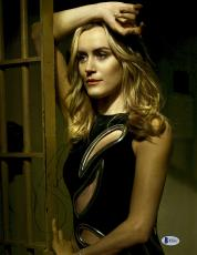 """Taylor Schilling Autographed 11"""" x 14"""" Orange is The New Black Posing in Black Dress Photograph - Beckett COA"""