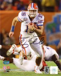 Tim Tebow Florida Gators Autographed 8'' x 10'' Running Photograph - Mounted Memories