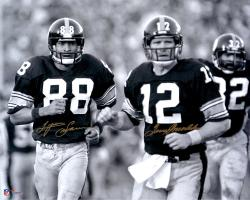 "Terry Bradshaw & Lynn Swann Pittsburgh Steelers Dual Autographed 16"" x 20"" Black & White Jogging Photograph"