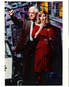 "THE NAKED GUN"" Signed by LESLIE NIELSEN as LT. FRANK DREBIN and PRISCILLA PRESLEY as JANE SPENCER 8x10 Color Photo"