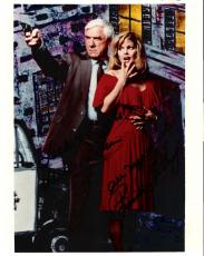 "THE NAKED GUN"" Signed by LESLIE NIELSEN as LT. FRANK DREBIN and PRISCILLA PRESLEY as JANE SPENCER 8x10 Color Photo"