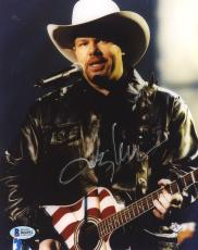"Toby Keith Autographed 8"" x 10"" Playing American Flag Guitar Photograph - Beckett COA"