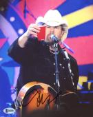 "Toby Keith Autographed 8"" x 10"" Playing Guitar Holding Red Solo Cup Photograph - Beckett COA"