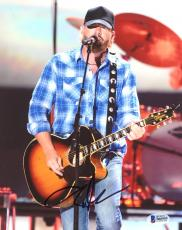 "Toby Keith Autographed 8"" x 10"" Playing Guitar In Blue Shirt & Black Hat Photograph - Beckett COA"