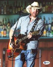 "Toby Keith Autographed 8"" x 10"" Playing Guitar Wearing White Cowboy Hat Photograph - Beckett COA"