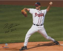 Tom Glavine Atlanta Braves Autographed 8'' x 10'' White Uniform Pitching Photograph with the inscirption HOF 14 Inscription - Mounted Memories