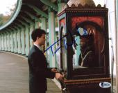 "Tom Hanks Autographed 8"" x 10"" Big Playing with Fortune Teller Machine Photograph - Beckett COA"