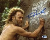 "Tom Hanks Autographed 8"" x 10"" Cast Away Writing on Rock Photograph - Beckett COA"