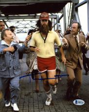 "Tom Hanks Autographed 8"" x 10"" Forrest Gump Running Marathon with News Reporters Photograph - Beckett COA"