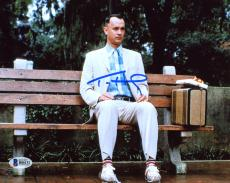 "Tom Hanks Autographed 8"" x 10"" Forrest Gump Sitting on Bench in Park with Suitcase & Gift Photograph - Beckett COA"