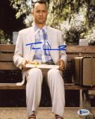 "Tom Hanks Autographed 8"" x 10"" Forrest Gump Sitting on Bench in Park with Suitcase & Gift Vertical Photograph - Beckett COA"