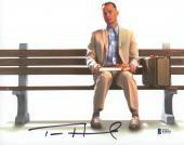 "Tom Hanks Autographed 8"" x 10"" Forrest Gump Sitting on Bench with Gift Horizontal Photograph - Beckett COA"