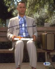 "Tom Hanks Autographed 8"" x 10"" Forrest Gump Sitting on Bench with Gift Vertical Photograph - Beckett COA"