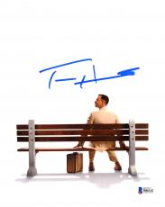 "Tom Hanks Autographed 8"" x 10"" Forrest Gump Sitting on Bench with Suitcase from Behind White Background Photograph - Beckett COA"