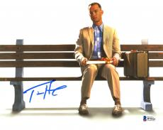 "Tom Hanks Autographed 8"" x 10"" Forrest Gump Sitting on Bench with Suitcase & Gift White Background Photograph - Beckett COA"