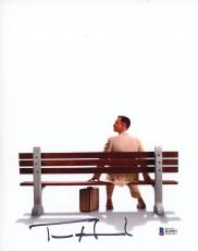 "Tom Hanks Autographed 8"" x 10"" Forrest Gump Sitting on Bench with Suitcase Photograph - Beckett COA"