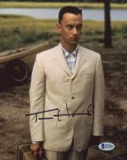 "Tom Hanks Autographed 8"" x 10"" Forrest Gump Standing with Suitcase Photograph - Beckett COA"