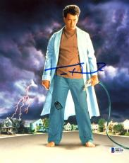 "Tom Hanks Autographed 8"" x 10"" The Burbs Standing in The Middle Of Street Holding Hose & Spatula Photograph - Beckett COA"