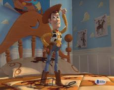 "Tom Hanks Autographed 8"" x 10"" Toy Story Woody Standing Photograph - Beckett COA"