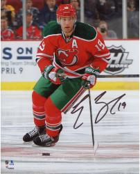 "Travis Zajac New Jersey Devils Autographed Red Jersey with Green Pants 8"" x 10"" Photograph"