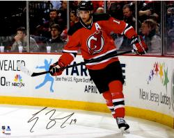 """Travis Zajac New Jersey Devils Autographed Skating by Boards 16"""" x 20"""" Photograph"""