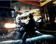 John Travolta Autographed 11'' x 14'' Shooting Gun Photograph
