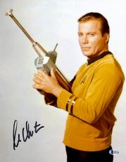 "William Shatner Autographed 11"" x 14"" Star Trek Holding Phaser Photograph - Beckett COA"