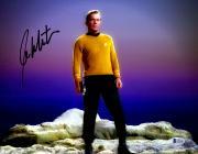 "William Shatner Autographed 11"" x 14"" Star Trek Standing on Rock Photograph - Beckett COA"