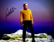 "William Shatner Autographed 11"" x 14"" Star Trek Standing on Rock Photograph - Beckett COA"