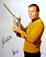 "William Shatner Autographed 16"" x 20"" Star Trek Holding Phaser Photograph with Kirk Inscription - Beckett COA"