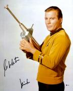 "William Shatner Autographed 16"" x 20"" Star Trek Holding Phaser Photograph with Kirk Inscription - Beckett COA"