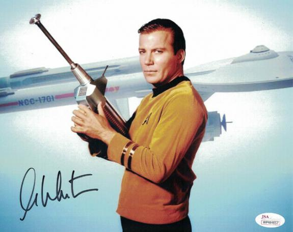 William Shatner Autographed Star Trek 8x10 Photo with Phaser JSA 14690