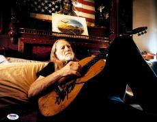 "Willie Nelson Autographed 11""x 14"" Playing Guitar In Bed With Black Ink Photograph - PSA/DNA COA"