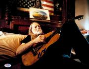 "Willie Nelson Autographed 11""x 14"" Playing Guitar In Bed With Blue Ink Photograph  - PSA/DNA COA"