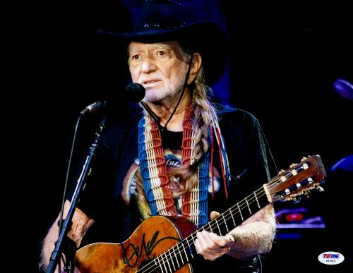 """Willie Nelson Autographed 11""""X 14"""" Playing Guitar Wearing Black Hat With Black Background Photograph - PSA/DNA COA"""