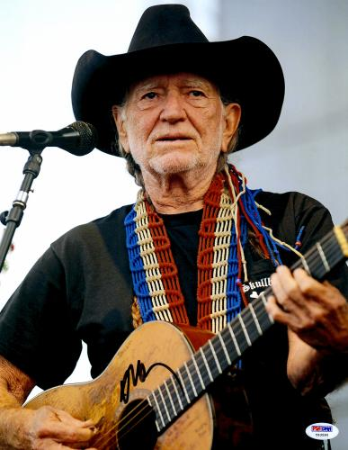 """Willie Nelson Autographed 11""""X 14"""" Playing Guitar Wearing Black Hat With White Background Black Ink Photograph - PSA/DNA COA"""