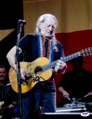 """Willie Nelson Autographed 11""""X 14"""" Playing Guitar With No Hat & Wearing Black Shirt Photograph - PSA/DNA COA"""