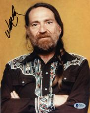 "Willie Nelson Autographed 8""x 10"" Arms Folded Photograph With Black Ink - Beckett COA"