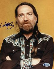 "Willie Nelson Autographed 8""x 10"" Arms Folded Photograph With Blue Ink - Beckett COA"